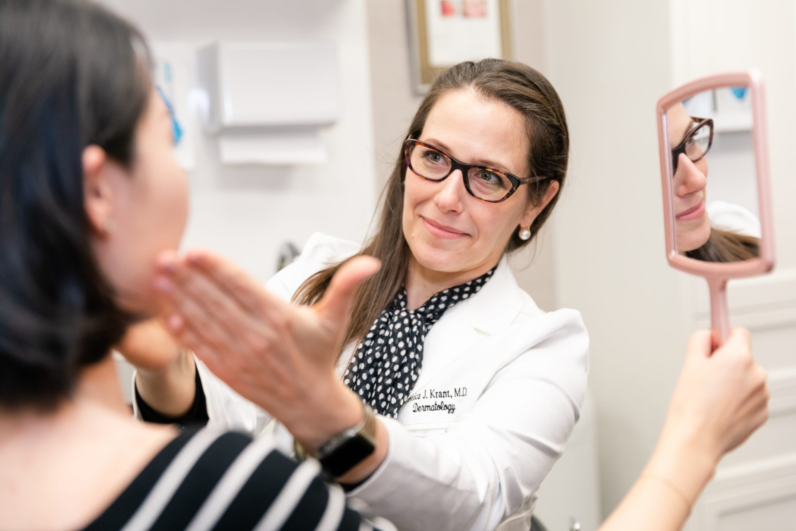 NYC dermatologist with a mole removal patient in NYC, NY