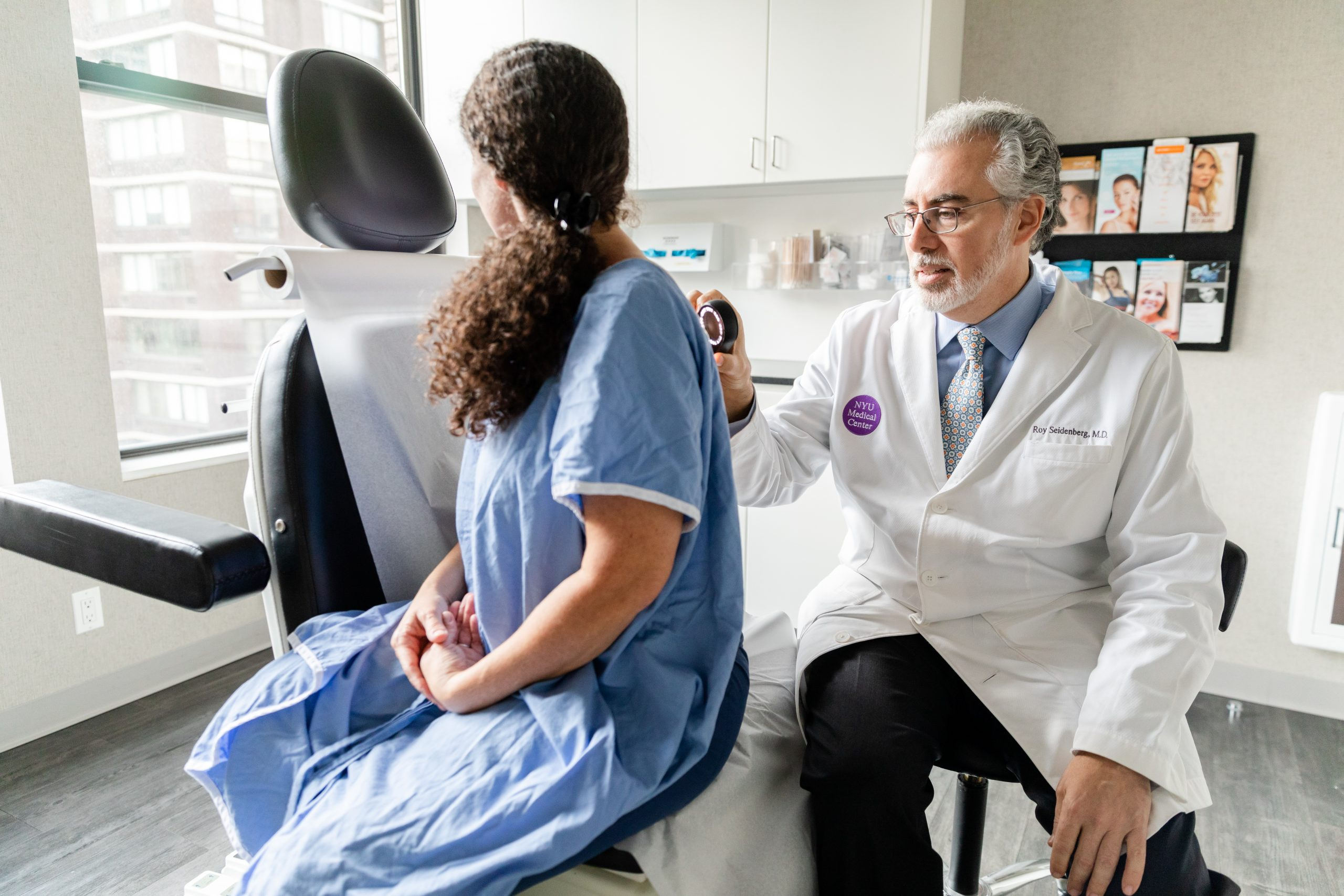 Image showing doctor examining a female patient for psoriasis, NYC NY