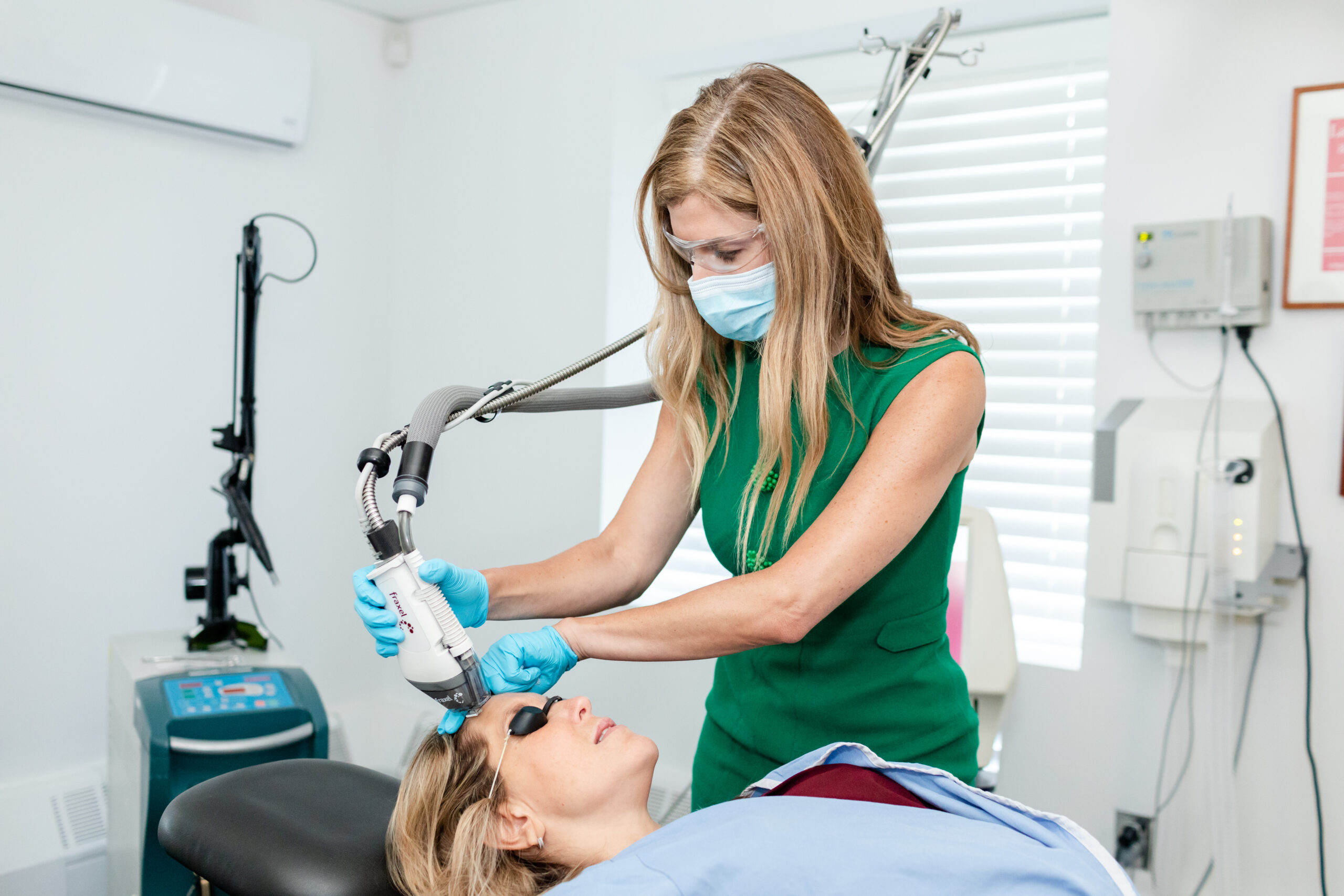Board Certified Dermatologist, Dr. Murphy-Rose is performing laser on her patient to treat redness in the face in NYC, NY.