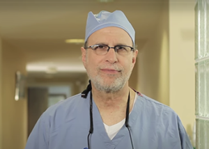 Image if plastic surgeon Dr. Lloyd Hoffman in operation scrubs in NYC, NY.